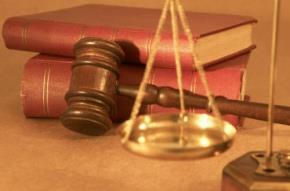 Sự thể hiện của nguyên tắc suy đoán vô tội trong chế định về xét xử