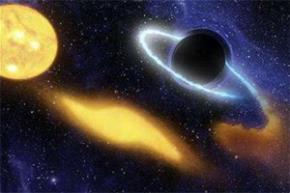 Một hình ảnh mô tả cảnh lỗ đen (bên phải) xé và nuốt một ngôi sao - Ảnh: Reuters